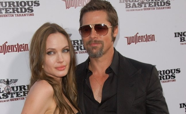 Cupid's Pulse Article: Brad Pitt Says He and Angelina Jolie Are Used to Taking Punches