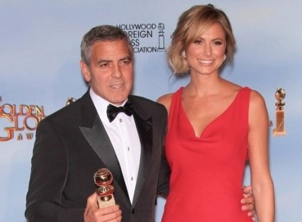 George Clooney and Stacy Keibler. Photo: Andrew Evans / PR Photos