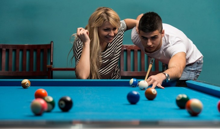 Couple playing pool. Photo: Jasminko Ibrakovic / Bigstock.com