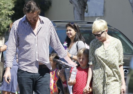 Jason Segel and Michelle Williams with Matilda. Photo: FAMEFLYNET