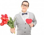 Guy with flowers on Valentine's Day. Photo: buso23 / Bigstock.com