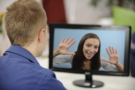 Couple virtually communicating. Photo: mangostock / Bigstock.com