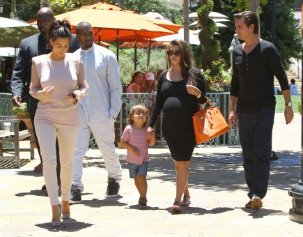 Kim Kardashian, Kanye West, Kourtney Kardashian and Scott Disick. Photo: FAMEFLYNET
