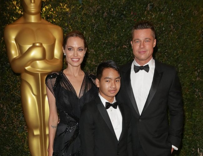 Celebrity Couples Who Have Adopted Children: Angelina Jolie and Brad Pitt with son Maddox