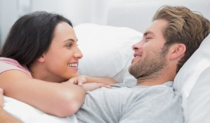 Loving couple laying in bed. Photo: Wavebreak Media Ltd / Bigstock.com