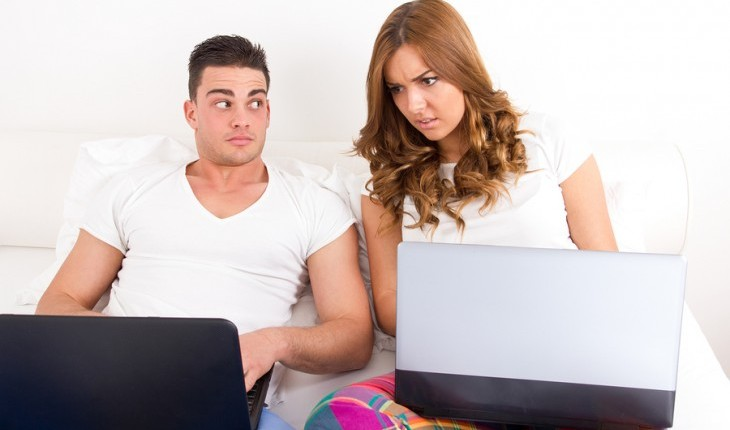 Upset girl looking at her boyfriend's computer. Photo: Feel Photo Art / Bigstock.com