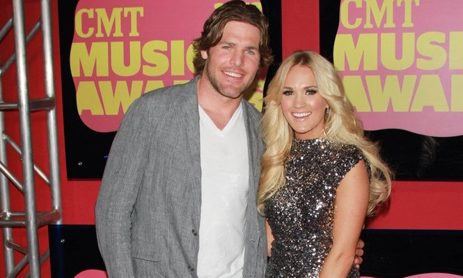 Cupid's Pulse Article: Celebrity News: Carrie Underwood Kisses Husband Mike Fisher After Winning the CMT Female Music Video of the Year