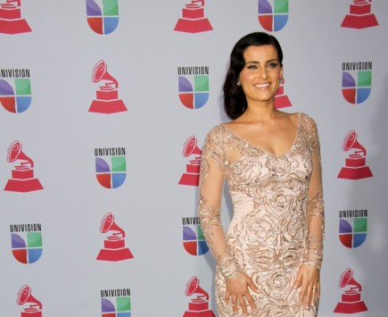 Nelly Furtado on Working with her Husband, Demacio Castellon