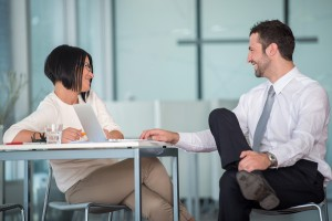 Two co-workers flirting with each other. Photo:  zurijeta / Bigstock.com