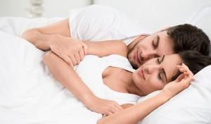 Couple sleeping in bed. Photo: IuriiSokolov / Bigstock.com