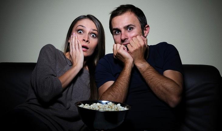 couple watching movie, scared couple, halloween, couple on halloween, date idea