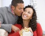 Husband and wife affectionately exchanging gifts. Photo: monkeybusinessimages / Bigstock.com