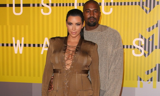 Cupid's Pulse Article: Celebrity Couple News: Kanye West Helped Kim Kardashian Fight Back During Nude Selfie Controversy