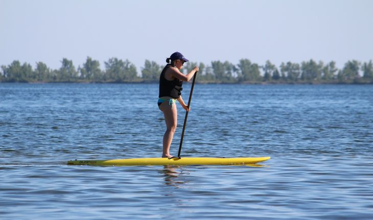 Cupid's Pulse Article: Find Your Balance On Date Night With Stand Up Paddle Boarding In New York