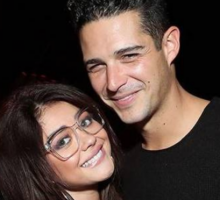 Celebrity Couple: Sarah Hyland & Wells Adams Get Cozy on Super Bowl Date Night